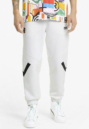 INTERNATIONAL - Tracksuit bottoms - puma white