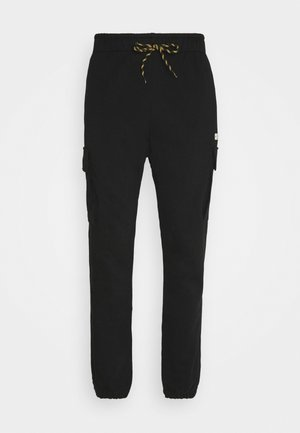 CAT SMALL LOGO CARGO  - Tracksuit bottoms - black