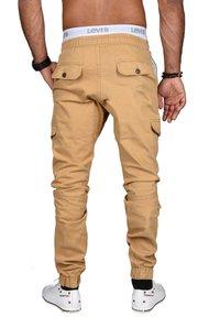 Alessandro Salvarini - DESIGNER - Cargo trousers - beige - 1