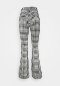 ONLY - ONLZIGA FLARED PANTS - Trousers - black/cloud dancer - 1