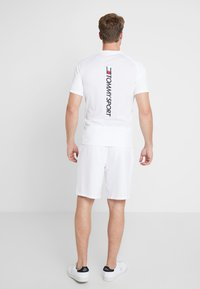 Tommy Hilfiger - CORE SHORT  - Pantalón corto de deporte - white - 2