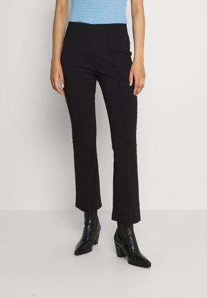 VIMARIKKA - Trousers - black