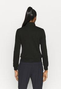 Puma - AMPLIFIED TRACK JACKET - Training jacket - black - 2