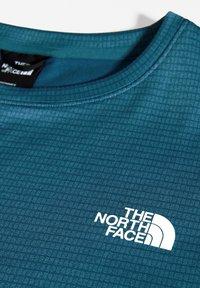 The North Face - M TRAIN N LOGO CREW - Collegepaita - mallard blue - 2