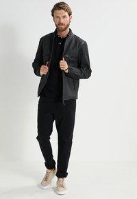 Tommy Hilfiger - PERFORMANCE REGULAR FIT - Polo - black - 1