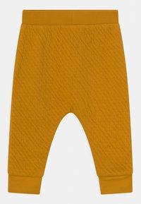 Sense Organics - NALU BABY UNISEX - Trousers - mustard - 0