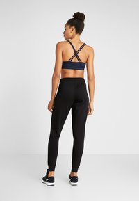 Cotton On Body - GYM TRACKPANT - Tracksuit bottoms - black - 2