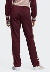 adidas Originals - FIREBIRD TRACKSUIT BOTTOMS - Tracksuit bottoms - burgundy - 1