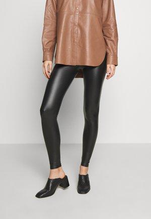 HAKI - Leggings - Trousers - black