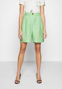 EDITED - JOANIE BERMUDA - Shorts - cameo green - 0