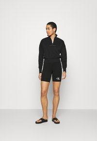 Calvin Klein Jeans - PRIDE CYCLING - Shorts - black - 1