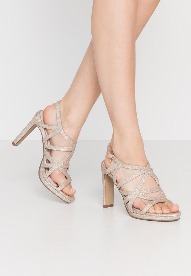 High heeled sandals - champagne