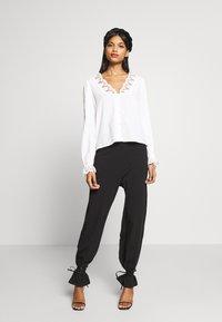 CALANDO - COMFY STRAIGHT LEG TROUSERS - Trousers - black - 1