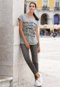 Laura Kent - Slim fit jeans - black - 1