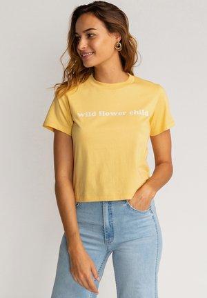 WILD CHILD  - Print T-shirt - pale yellow