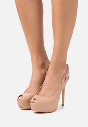 GINNIA - Platform heels - beige neutro