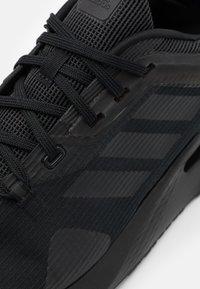 adidas Performance - ALPHATORSION - Neutral running shoes - core black - 5