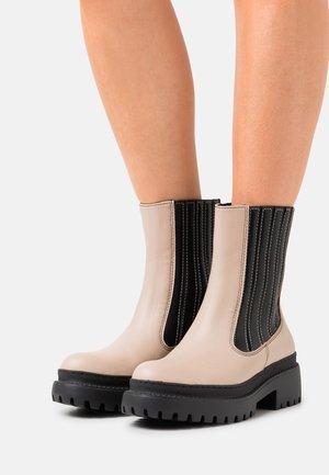 VEGAN IRLANDA - Platform ankle boots - beige