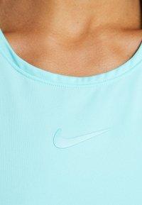 Nike Performance - DRY DRESS - Sportovní šaty - light aqua/white - 5
