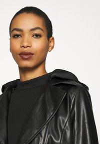 Calvin Klein Jeans - LOGO ELASTIC DRESS - Sukienka z dżerseju - black - 3