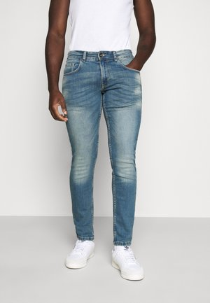 STOCKHOLM - Slim fit jeans - dusty blue