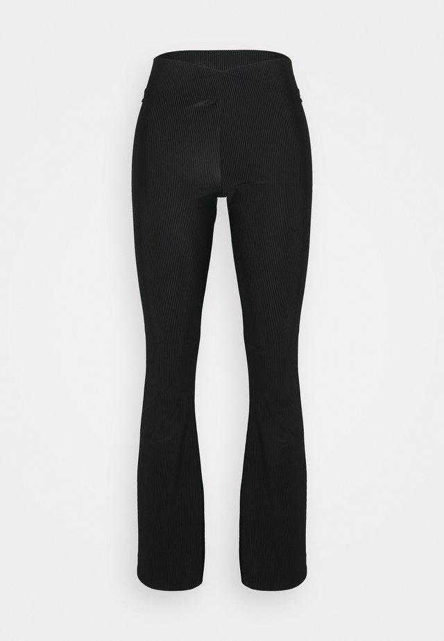 FLARED PANT - Træningsbukser - black