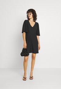 Vero Moda - VMODETTA DRESS - Jersey dress - black - 1