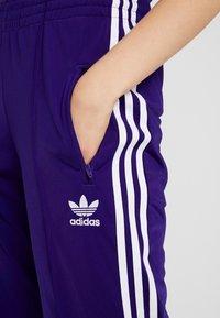 adidas Originals - FIREBIRD ADICOLOR TRACK PANTS - Verryttelyhousut - collegiate purple - 4