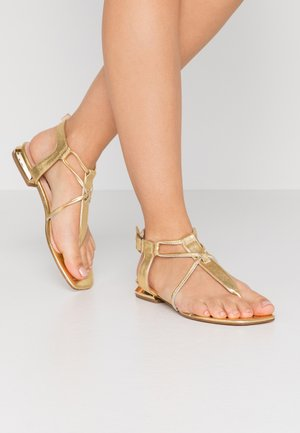 CRETA - Sandály s odděleným palcem - platino