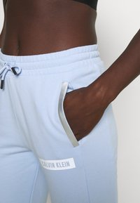 Calvin Klein Performance - PANTS - Tracksuit bottoms - sweet blue - 3
