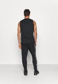 Nike Performance - CAMO - Tracksuit bottoms - black/white - 2
