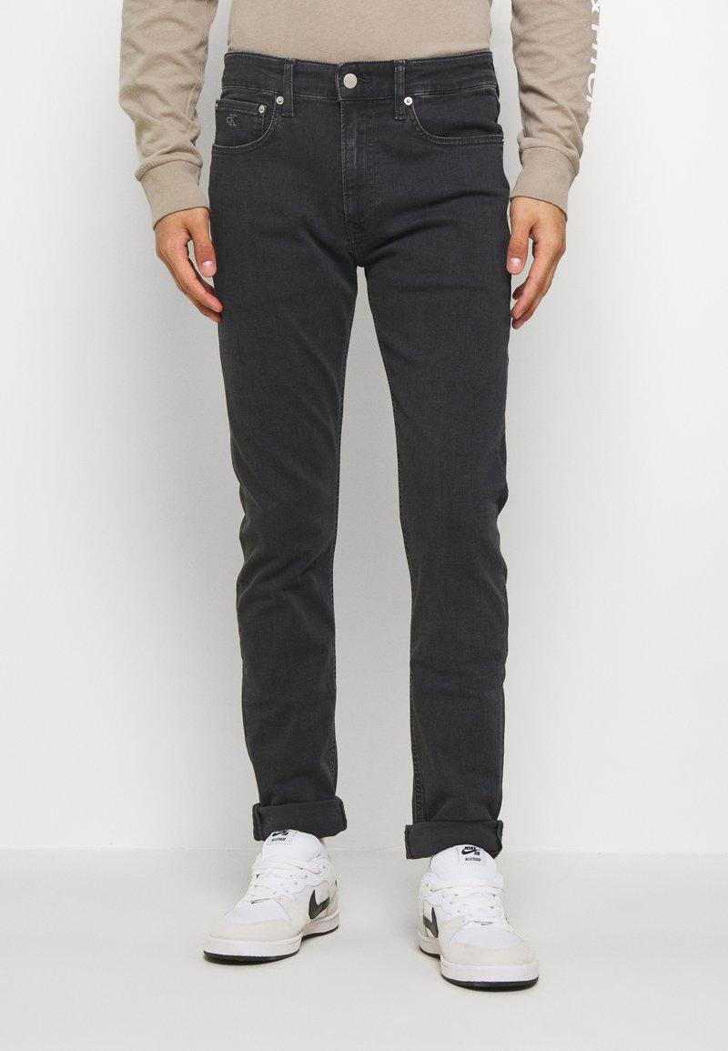 Calvin Klein Jeans - CKJ 016 SKINNY - Slim fit -farkut - grey