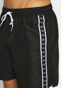 Calvin Klein Swimwear - MEDIUM DRAWSTRING - Swimming shorts - black - 3