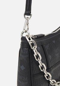 MCM - DELMY SHOULDER BAG IN VISETOS - Handbag - black - 3