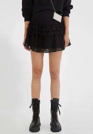 NEEA VOLANTS  - A-line skirt - black