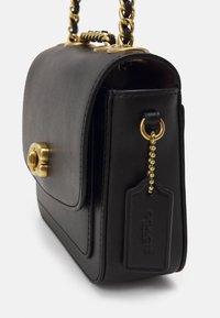Coach - MADISON SHOULDER BAG - Across body bag - black - 4