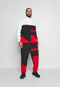 Nike Performance - FLIGHT TRACKSUIT - Tuta - black/white/university red - 1