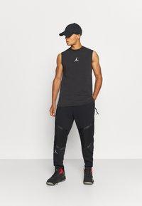 Jordan - ZION WILLIAMSON PANT - Spodnie treningowe - black/white - 1