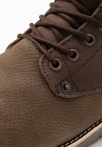 Levi's® - JAX - Lace-up ankle boots - dark brown - 5