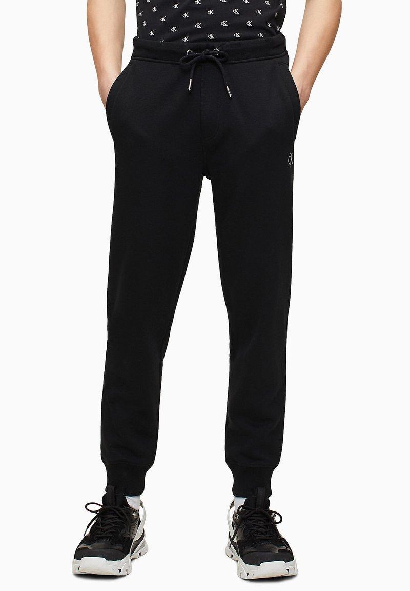 Calvin Klein Jeans - Tracksuit bottoms - ck black