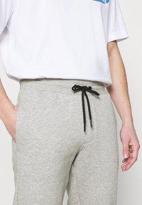 Redefined Rebel - REID PANTS - Tracksuit bottoms - light grey melange - 5
