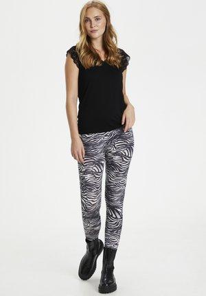 CUSEMIRA  - Legging - zebra