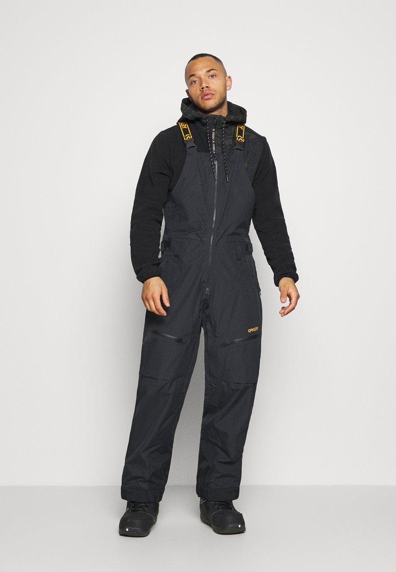 Oakley - GUNN SHELL BIB - Snow pants - blackout