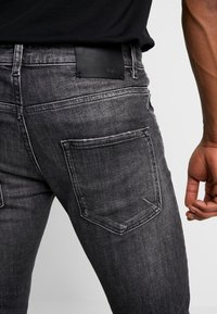 Tigha - BILLY THE KID - Slim fit jeans - mid grey - 5