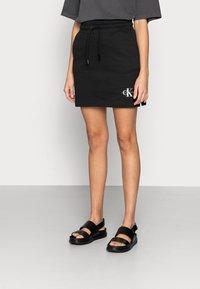 Calvin Klein Jeans - MONOGRAM HEAVYWEIGHT SKIRT - Mini skirt - black - 0