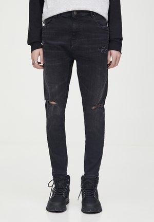 KAROTTENJEANS MIT SCHLITZEN 09684547 - Jeans Tapered Fit - black