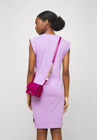 Versace Jeans Couture - CHARMS CROSSBODY - Across body bag - fuxia - 0