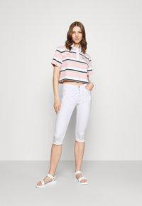 Vero Moda - VMSEVEN BUTTON FLY - Denim shorts - bright white - 1