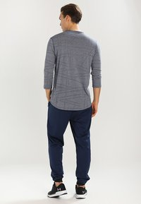 Under Armour - SPORTSTYLE - Tracksuit bottoms - academy - 2