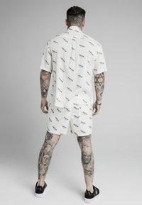SIKSILK - REPEAT PRINT SWIM - Shorts - off white - 2